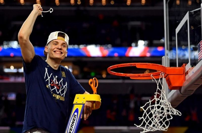 Virginia Cavaliers guard Kyle Guy (5) cuts down the net after beating the Texas Tech Red Raiders in the championship game of the 2019 men's Final Four at US Bank Stadium.