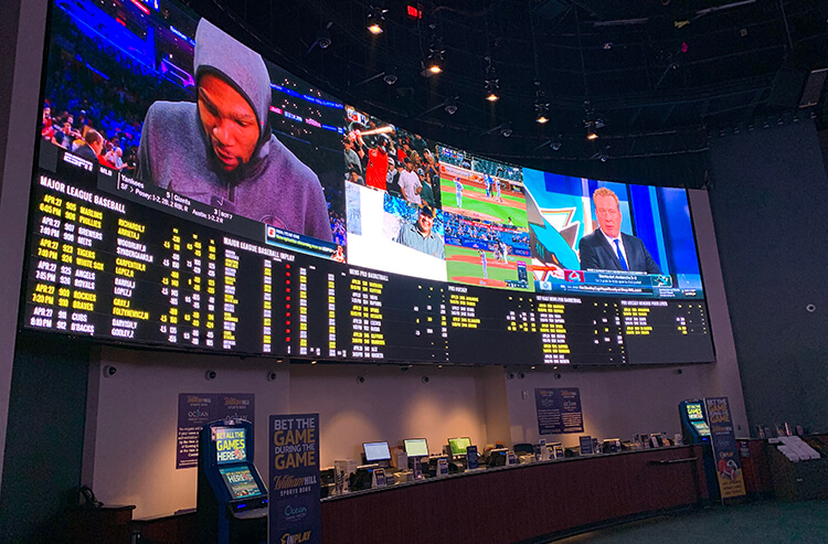 One of two giant video walls at the William Hill Sportsbook at Ocean Resort Atlantic City is one of the most luxurious sportsbooks in all of New Jersey.