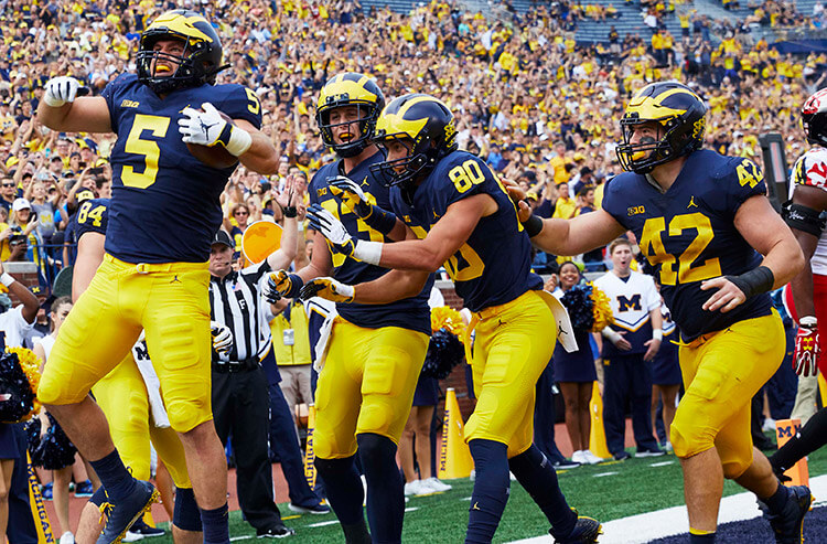 Sharp college football bettors jump on Michigan odds in Big Ten battle vs. Wisconsin