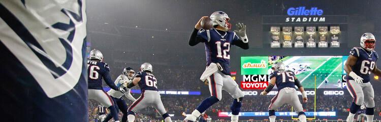 Tom Brady leads the Patriots inside Gillette Stadium