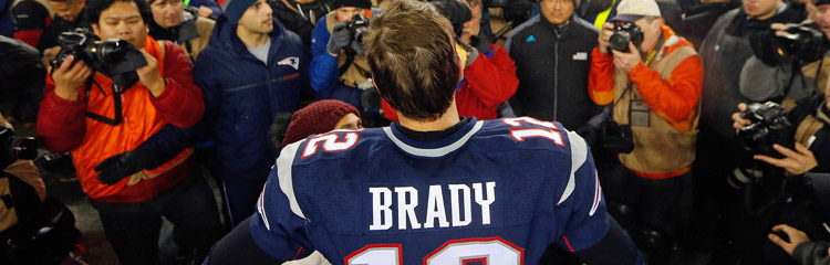 Tom Brady is approached by the press after a win